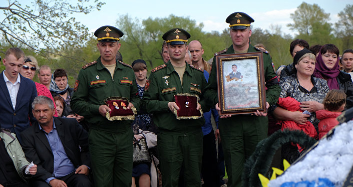 The funeral of Alexander Prokhorenko, a Russian special forces officer killed in action in Syria on March 17.