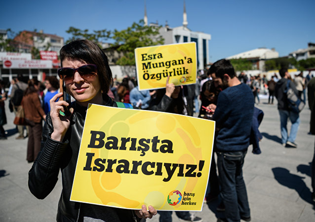 A campaigner holds a placard reading  We want peace!  during a rally in Istanbul.