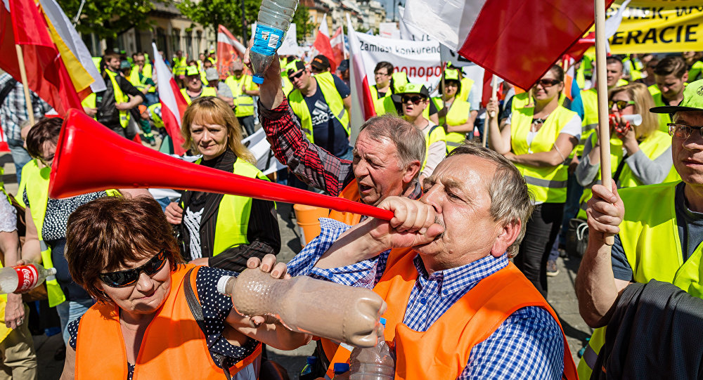 Garbage collectors working for private companies protest against governmental law changing plans, in Warsaw, Poland, on May 10, 2016