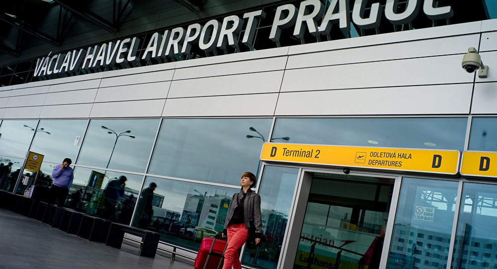 A woman leaves the Vaclav Havel airport in the Czech capital Prague on October 5, 2012
