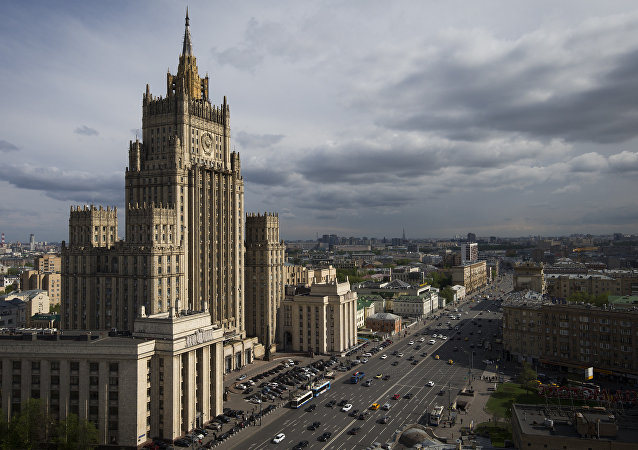 Cars drive past the Russian Foreign Ministry.