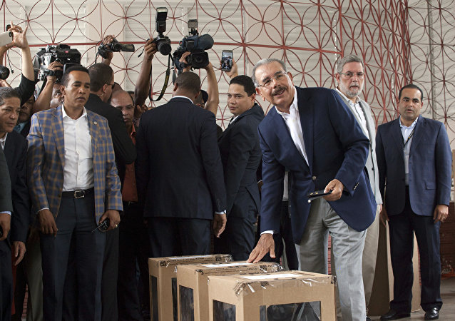 Danilo Medina, current president and presidential candidate for the Dominican Liberation Party, casts his ballot during the general elections, in Santo Domingo, Dominican Republic, Sunday, May 15, 2016