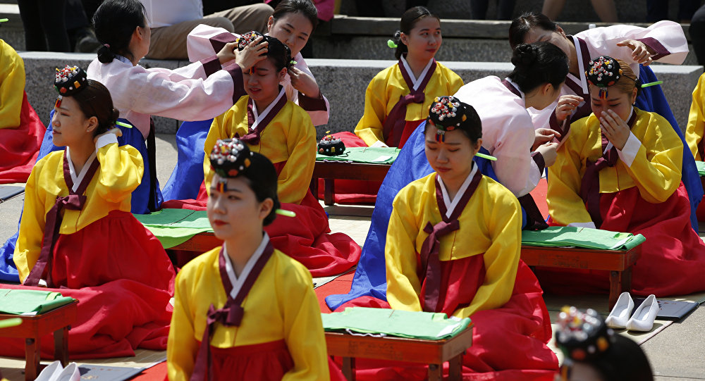 Women wearing South Korea traditional dresses, attend at the 44th Coming of Age Day ceremony in Seoul, South Korea, Monday, May 16, 2016