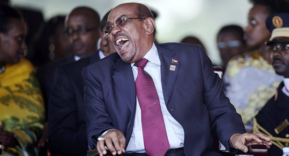 Sudan's President Omar Hassan al-Bashir laughs during the swearing-in ceremony of Uganda's president, Yoweri Kaguta Museveni at the Kololo independence grounds in Kampala, Uganda, May 12, 2016.