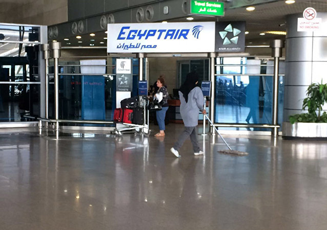 The Egyptair logo is seen at the arrivals section of Cairo International Airport, Egypt, Thursday, May 19, 2016