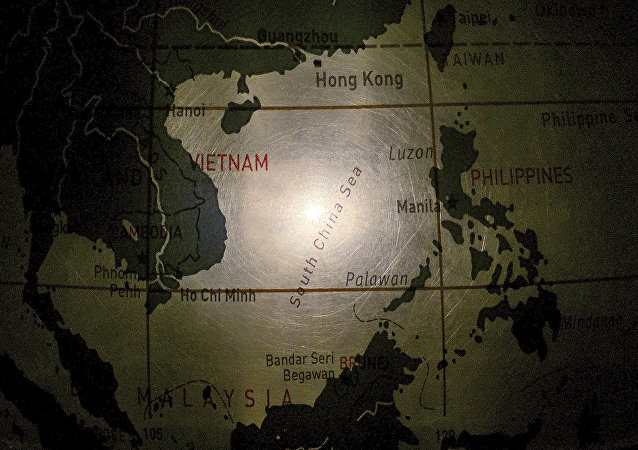 In this May 1, 2016, photo, an illuminated globe shows the South China Sea at a museum in Pathumthani, Thailand