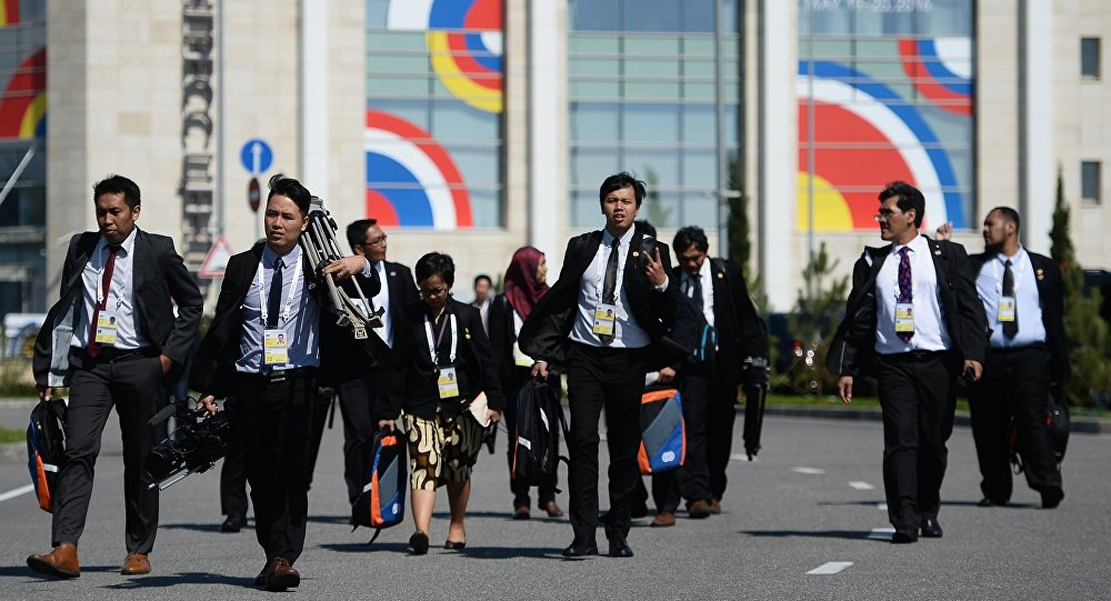 Journalists working at the International Press Centre for the ASEAN-Russia Summit near the congress centre in Sochi