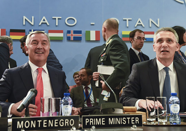 Montenegro's Prime Minister Milo Dukanovic (L) attends a NATO Foreign minister meeting next to NATO Secretary General Jens Stoltenberg (R) at the NATO headquarters in Brussels on May 19, 2016