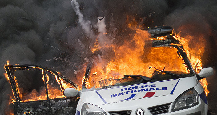 A police car explodes after being set on fire during an unauthorized counter-demonstration against police violence on May 18, 2016 in Paris, as Police across France demonstrate today against the anti-cop hatred they say they have endured during a wave of anti-government protests since early March