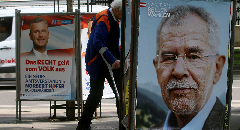A man walks between election posters of Alexander Van der Bellen, candidate for presidential elections and former head of the Austrian Greens, right, and Norbert Hofer, candidate for presidential elections of Austria's right-wing Freedom Party, FPOE, left, in Vienna, Austria