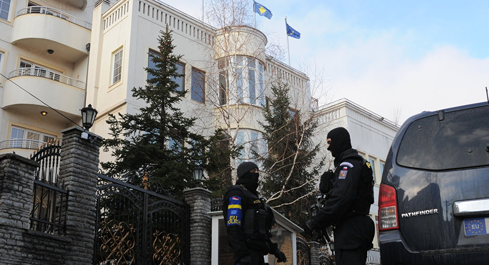 EU special unit police officers stand in front of the residence of Uke Rugova in Pristina on February 5, 2014. (File)