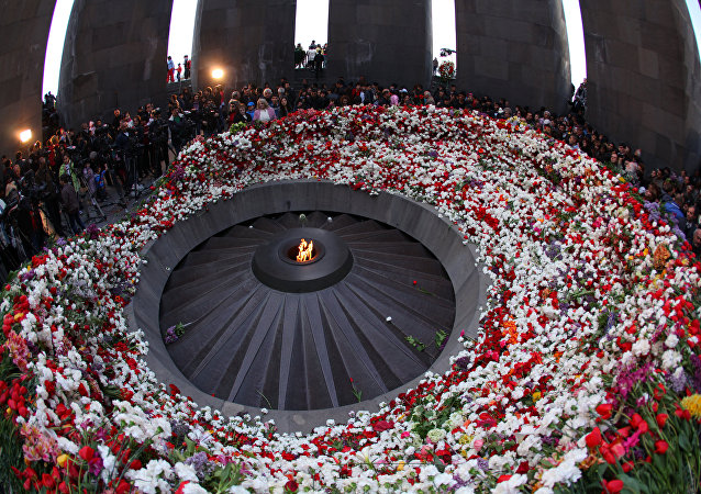 Residents of Yerevan and Armenian regions lay flowers to the Eternal Flame at the Tsitsernakaberd Armenian Genocide memorial in Yerevan
