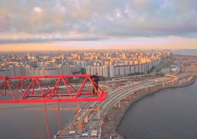 Russia: See base jumpers fly from 120-metre crane in St. Petersburg