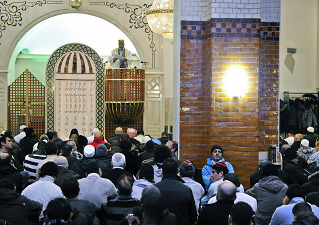 Imam Ben Mahmoud Rahman (back-C) speaks during Friday prayers at Stockholm's largest mosque (photo used for illustreation purpose)