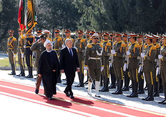 Iranian President Hassan Rouhani (L) walks next to Switzerland's President Johann Schneider during an official welcoming ceremony following the latter's arrival for talks, in the capital Tehran (File)