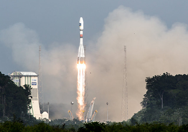 A picture taken on December 17, 2015 shows a Soyuz rocket blasting off from the European space centre at Kourou, French Guiana