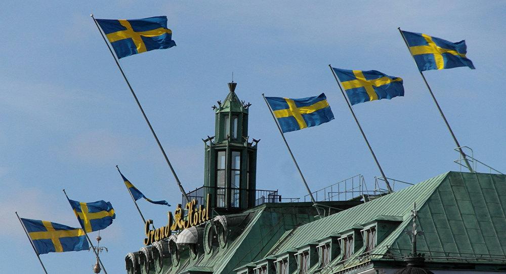 Swedish flags above the Grand Hotel, Blasieholmen, Stockholm, Sweden