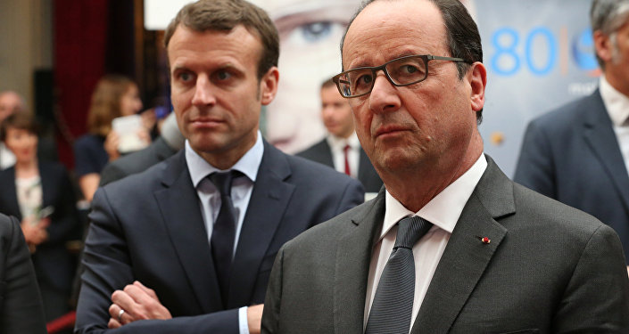 French Economy Minister Emmanuel Macron (L) alongside President Francois Hollande (R). File photo.