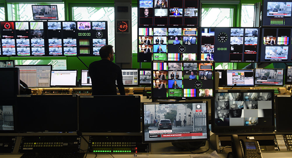 A picture taken on December 8, 2015 shows the control room in the new headquarters of the multilingual news television channel Euronews in the Confluence district, in Lyon, southeastern France