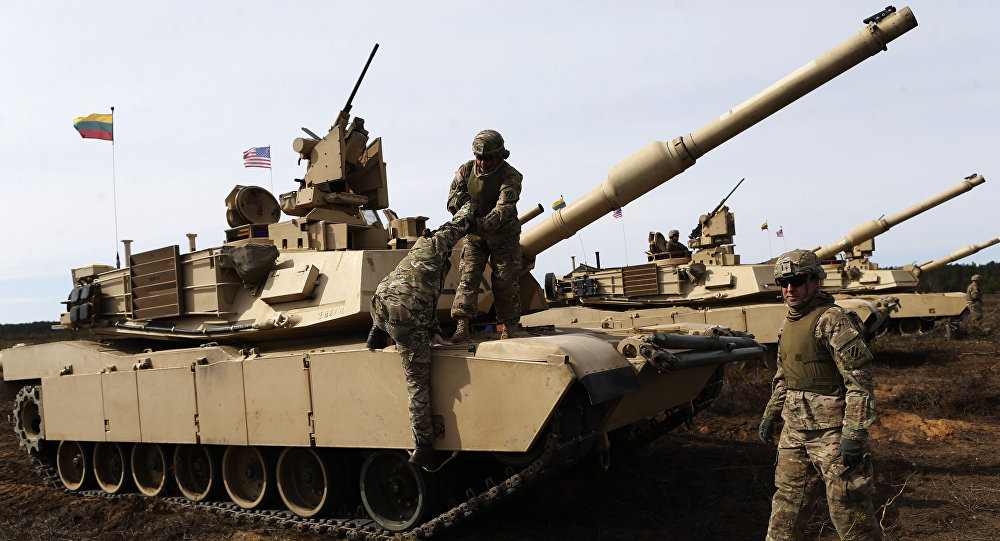 U.S. soldiers from the 2nd Battalion, 1st Brigade Combat Team, 3rd Infantry Division at the M1A2 Abrams battle tank during a military exercise at the Gaiziunu Training Range in Pabrade some 60km.(38 miles) north of the capital Vilnius, Lithuania