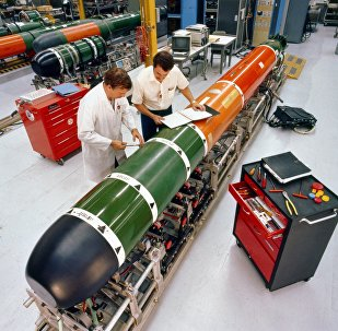 Technicians perform maintenance on a Mark 48 advanced capabilities torpedo at Keyport, Washington