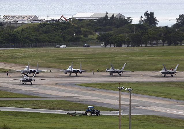 US Air Force F-22 Raptors, right, and two F-15 Eagles prepare for take-off at Kadena Air Base on the southern island of Okinawa, in Japan (File)