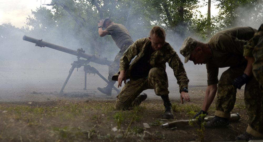 Ukrainian servicemen shout from SPG-9 antitank grenade launcher during the combat with the militia near Avdeevka, Donetsk region, on June 18, 2015