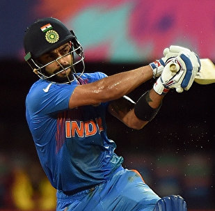 India's Virat Kohli plays a shot during the World T20 cricket tournament semi-final match between India and West Indies at The Wankhede Cricket Stadium in Mumbai on March 31, 2016