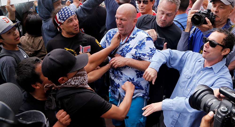 Trump supporters and anti-Trump demonstrators clash outside a campaign event for U.S. presidential candidate Donald Trump in San Diego, California, U.S. May 27, 2016.