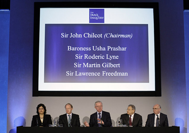 John Chilcot, center, the chairman of the Iraq Inquiry, sits with committee members