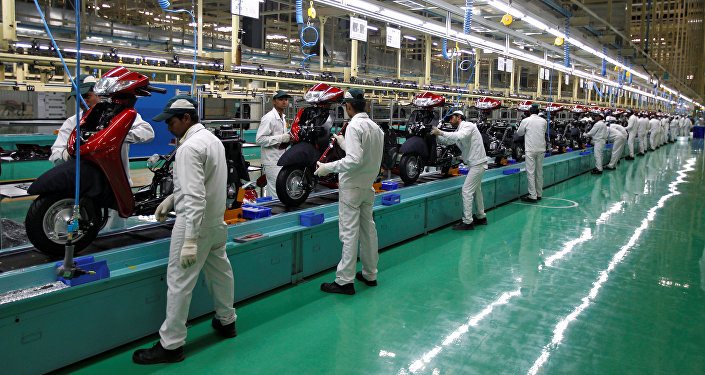 Employees work on an assembly line of Honda Motorcycle & Scooter India during a media tour to the newly inaugurated plant at Vithalapur town in the western state of Gujarat, India, February 17, 2016