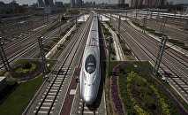 A CRH high-speed train leaves the Beijing South Station in Beijing, China, Tuesday, July 26, 2011