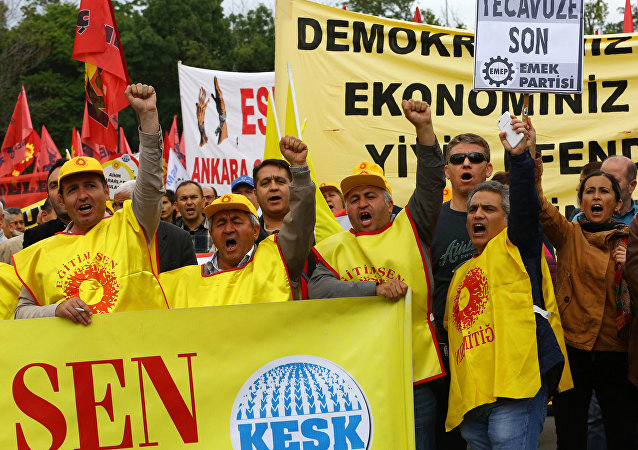Turkish worker union members gesture during an anti-government, pro-secularism protest on May 28, 2016 in Ankara. Turkish President Recep Tayyip Erdogan on MAy 22 gave his close ally and Transport Minister Binali Yildirim the mandate to form a government as prime minister in a move set to further consolidate the strongman's grip on power.