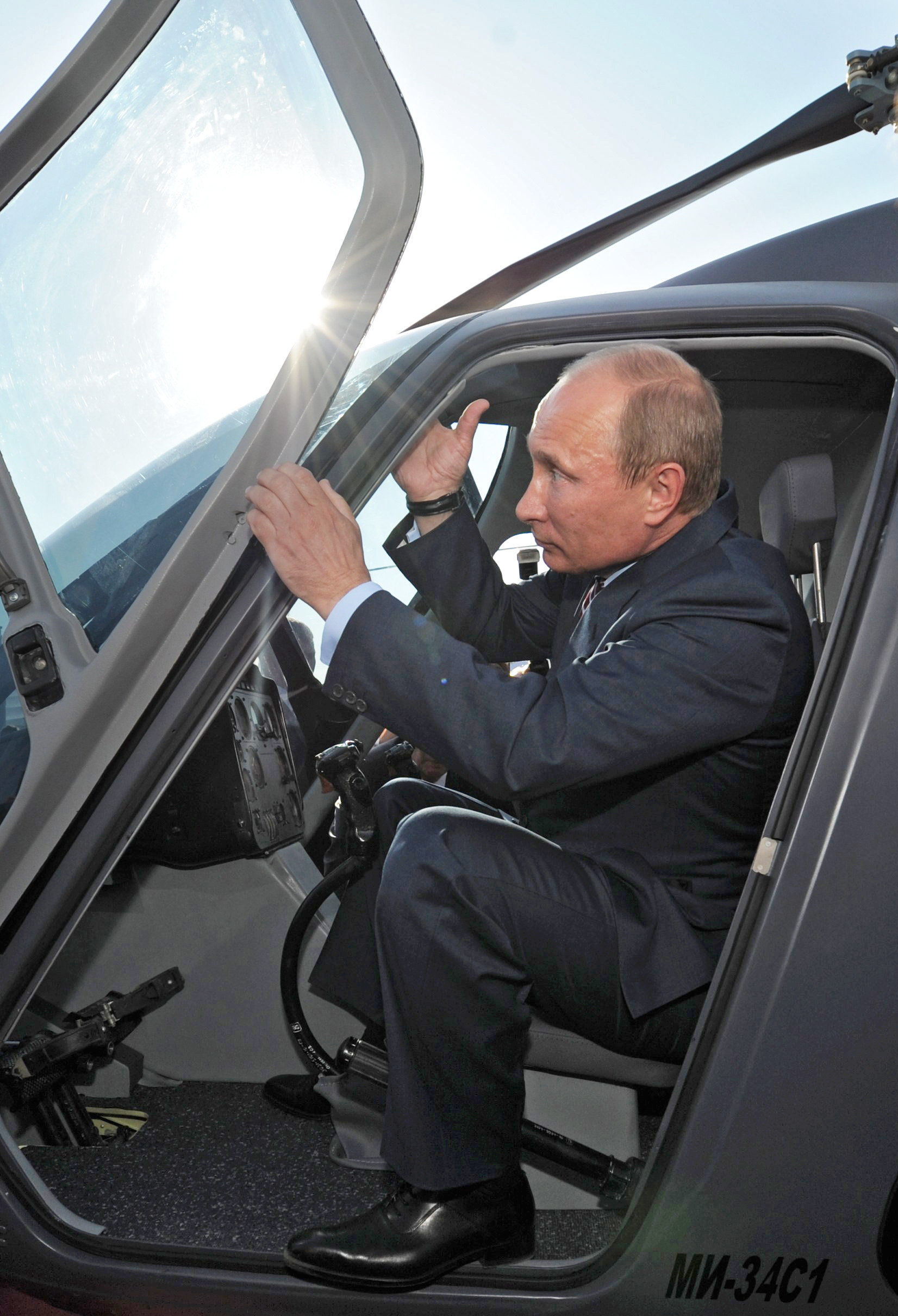 Russian President Vladimir Putin seen in the cockpit of the Mi-34 helicopter exhibited by the Russian Helicopters manufacturer. (File)