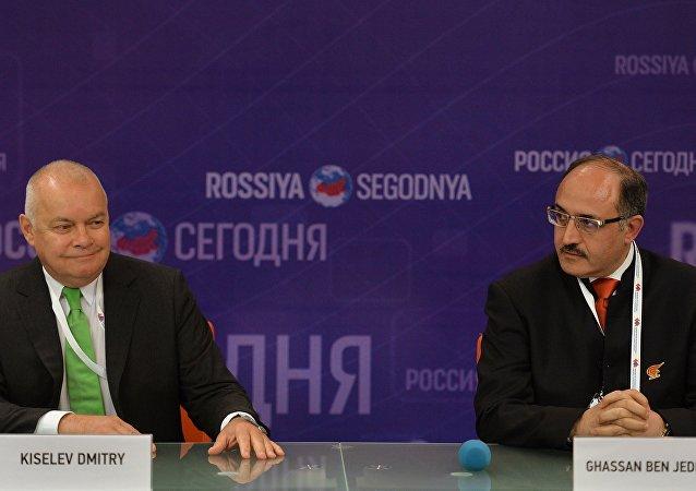 Dmitry Kiselev, left, Director General, Rossiya Segodnya International Information Agency, with Ghassan Ben Jeddou (Lebanon), Chairman of the Board of Directors, Al Mayadeen TV