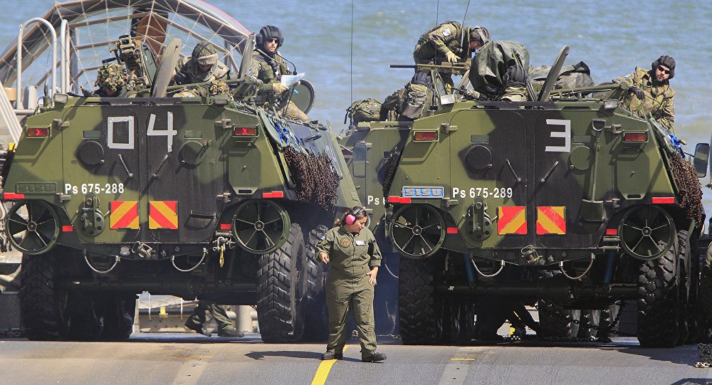 Soldiers park their amphibious vehicles on a ship as they participate in a massive amphibious landing during NATO sea exercises BALTOPS 2015 that are to reassure the Baltic Sea region allies in the face of a resurgent Russia, in Ustka, Poland, Wednesday, June 17, 2015