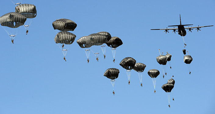 A file photo showing US troops land with parachutes at the military compound near Torun, central Poland, on June 7, 2016, as part of the NATO Anaconda-16 military exercise.