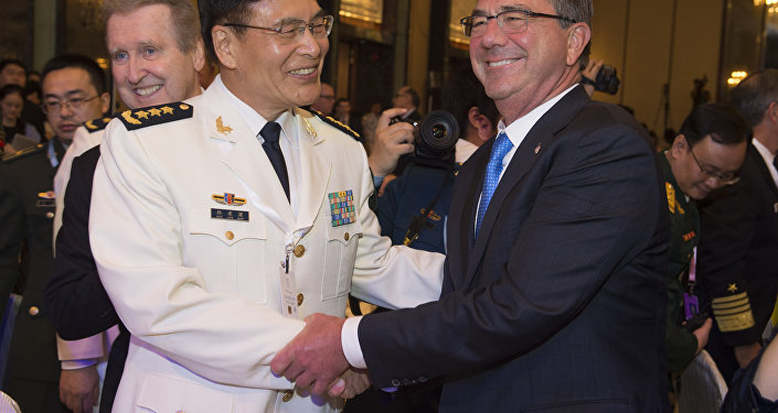 PLA Deputy Chief  General Staff Adm. Sun Jianguo and US Defense Secretary Ash Carter in Singapore