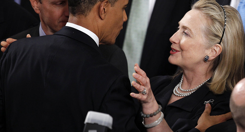 Former Secretary of State Hillary Rodham Clinton greets President Barack Obama after he delivered his State of the Union address on Capitol Hill in Washington.