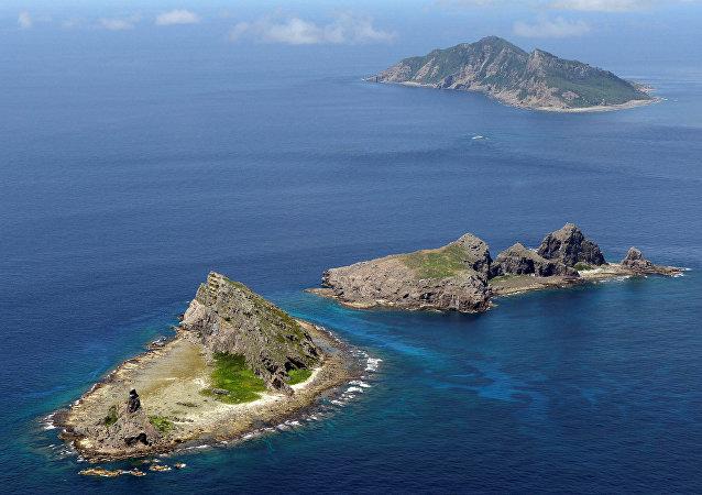 A group of disputed islands, Uotsuri island (top), Minamikojima (bottom) and Kitakojima, known as Senkaku in Japan and Diaoyu in China is seen in the East China Sea (File)
