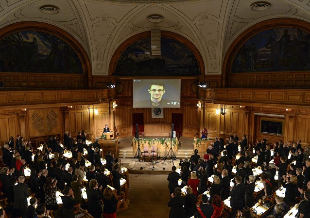 Fugitive US intelligence leaker Edward Snowden is shown on a livestream from Moscow during the Right Livelihood Award ceremony at the Swedish Parliament, in Stockholm, on December 1, 2014