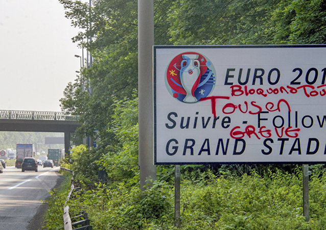 This picture taken on June 6, 2016 shows a tagged road board reading Let's block everything, all on strike over an exit road indication to a Euro 2016 stadium on the circular road of Lille, northern France 3 days before the beginning of the Euro 2016 championship.