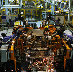 Sparks fly from a robot as it performs spot welding on a car on the production line at Honda Siel Cars India Ltd. (HSCI) factory in Noida, a satelite town on the outskirts of New Delhi on February 25, 2008