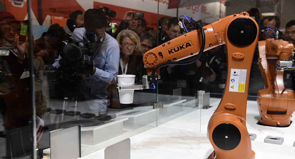 A robot prepares a cup of coffee at the booth of robotics manufacturer KUKA on the eve of the opening of the Hannover Messe (Hanover fair) in Hanover, northern Germany, on April 23, 2016