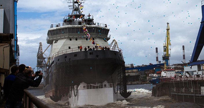 The new generation diesel-electric icebreaker Ilya Muromets being launched into the water from its drydock.