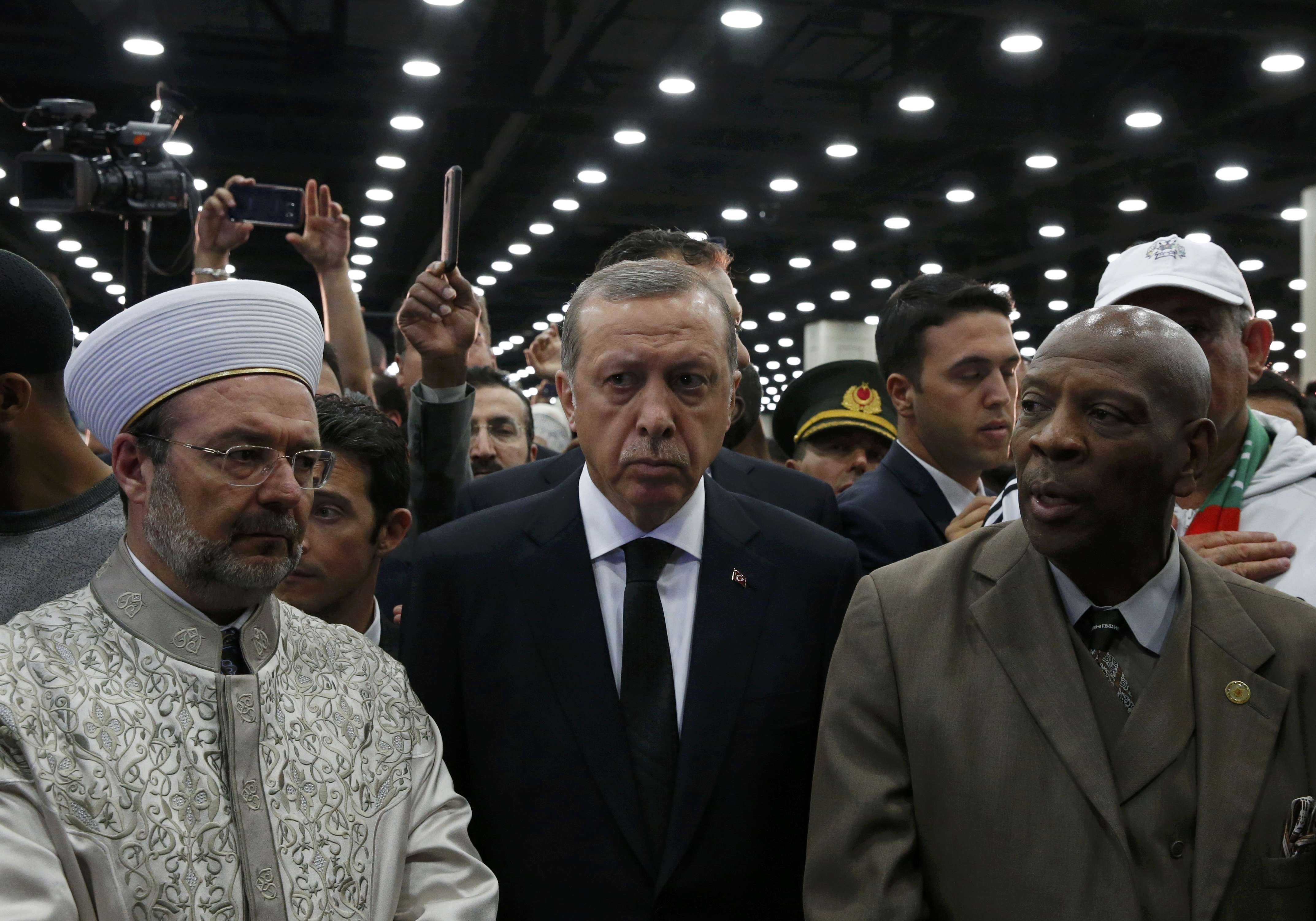 Turkish President Tayyip Erdogan (C) arrives to take part in the jenazah, an Islamic funeral prayer, for the late boxing champion Muhammad Ali in Louisville, Kentucky, U.S. June 9, 2016