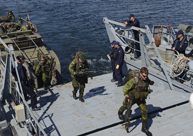 Swedish soldiers arrive aboard the Polish navy ship during the Baltops drills . file photo