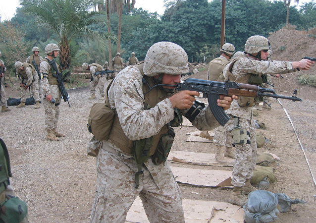 US Marine Lance Corporal Cheema firing the East German MpiKMS-72 variant of the AKM (updated version of the AK-47) assault rifle