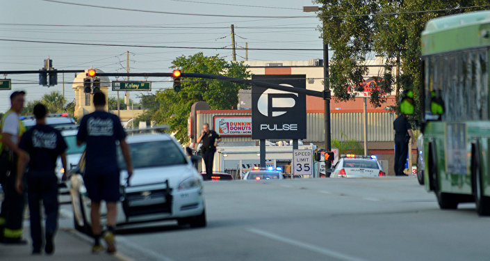 Police lock down Orange Avenue around Pulse nightclub, where people were killed by a gunman in a shooting rampage in Orlando, Florida June 12, 2016