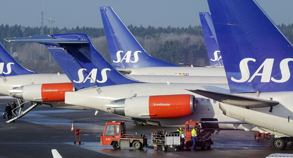 SAS aircraft are seen parked at the gates at terminal 4 of Arlanda Airport near Stockholm